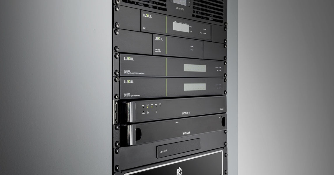Luxul routers and switches installed in a rack for network