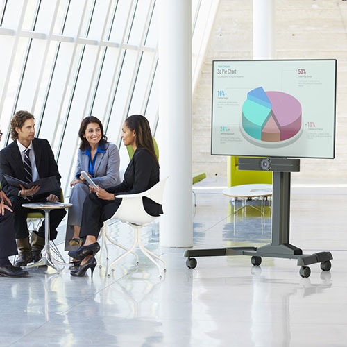 People meeting near a videoconferencing cart.