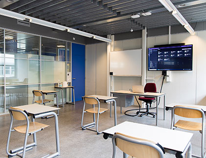 Classroom with camera, display and microphone.