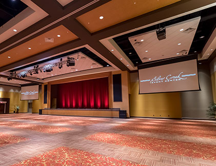 Customized Tensioned Professional screens flank the Silver Creek Event Center stage.