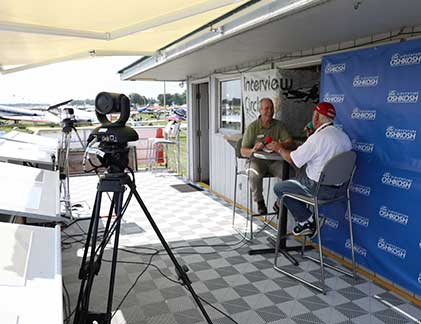 Vaddio camera aimed at two men doing an interview at the airshow