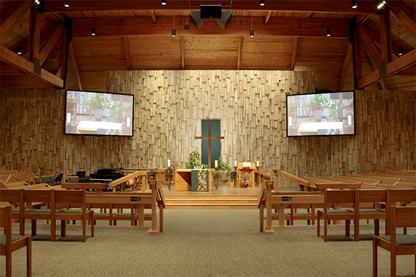 View of inside church with two Da-Lite screens flanking the altar.