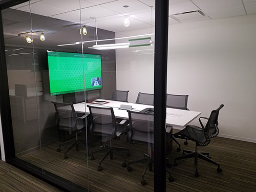 Conference room with Tempo holding display at one end