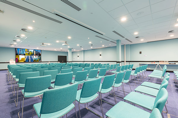Large conference room with projection screen.