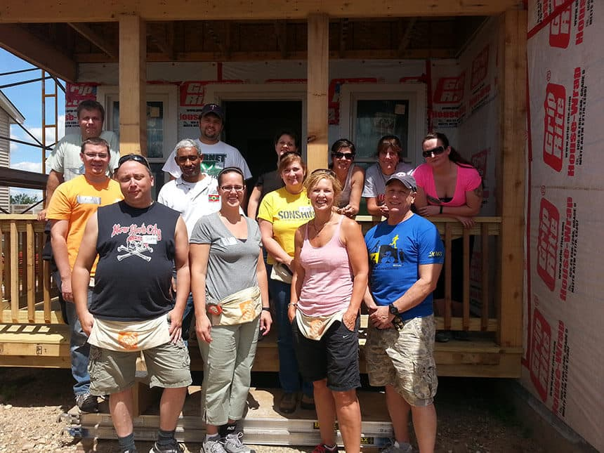 Milestone employees volunteer at Habitat For Humanity