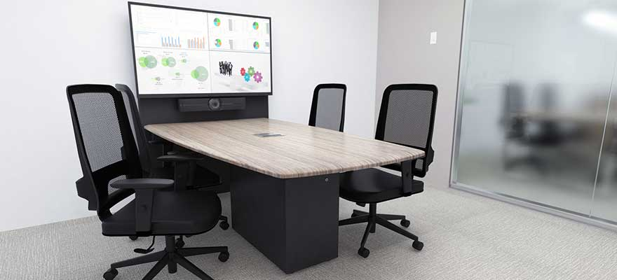 Huddle room with videoconferencing camera and display.