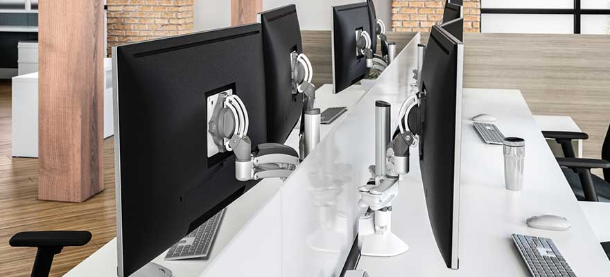 Desktop workspace with adjustable monitor arms.