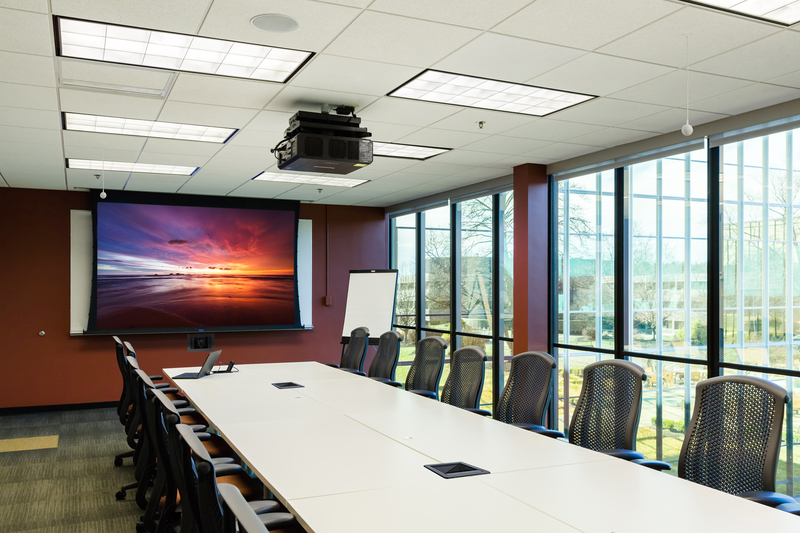 Large meeting room with overhead projector and Da-Lite screen