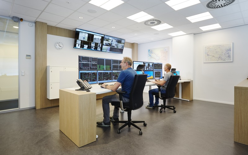 Hospital security control room with multiple monitors